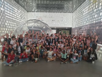 75 children aged 10 to 14 pose for a group picture after their Moon Camp experience