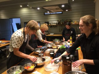 Members of the City Lab Tartu hosted by Science Centre AHHAA preparing lunch as part of Lab activities