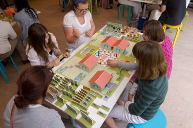 Children playing a board game on urban diversity at the BiodiverCITY Exhibition of the Royal Belgian Institute of Natural Sciences