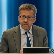EU Research Commissioner speaking at the European Open Science Cloud Summit. Credit: Science|Business