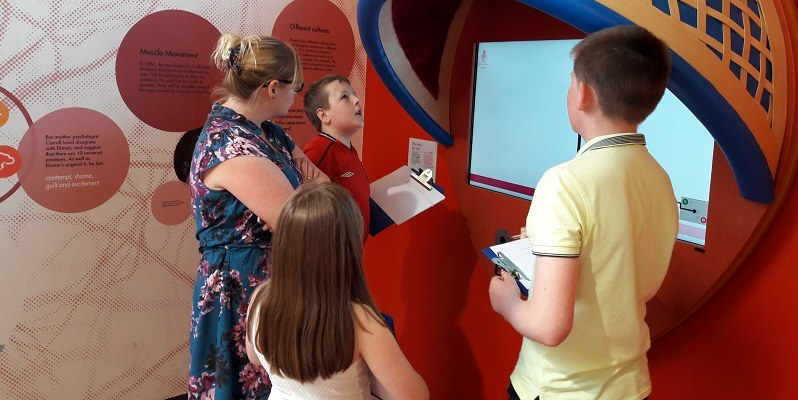 Kerrie and e=mc2 looking at exhibits in the Brain Zone, as part of Life's project for Young People with Autism Spectrum Disorders