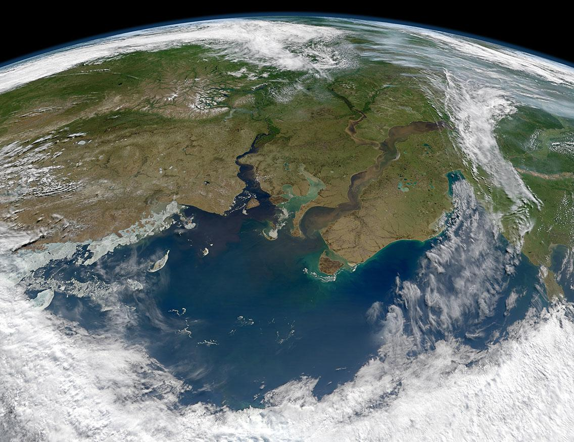 Earth from cupola_NASA image. Courtesy Norman Kuring, Ocean Color Web