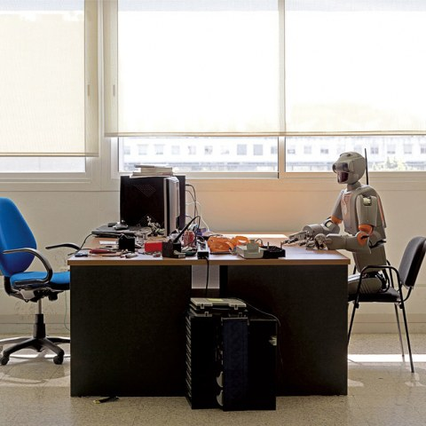 Robot sitting at a desk, part of Vincent Fournier's photography series The Man Machine. (c) 2010 Vincent Fournier
