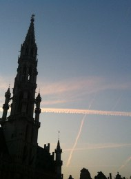 """Airplane condensation trails in the Brussels sky - which """"chemtrail"""" conspiracy theorists claim to be chemical substances governments spray to keep populations subdued. Photo Antonio Gomes da Costa"""