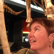 Kate Phillips looking at dinosaur skeletons