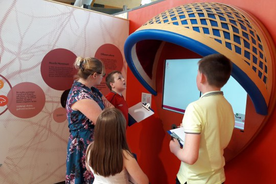 Kerrie and e=mc² looking at exhibits in the Brain Zone, as part of Life's project for Young People with Autism Spectrum Disorders