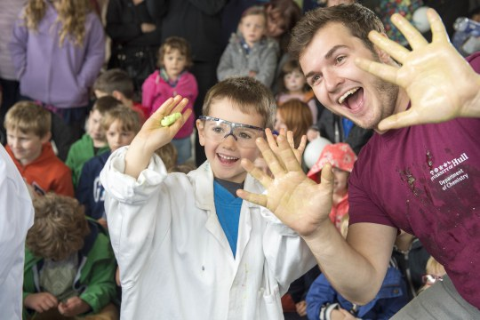 Phil Bell-Young presenting the University of Hull Science Show 'Battle of the Slime' to a public audience at the Hull Freedom Festival.