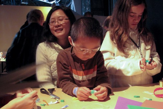 Young people and caregivers play and learn together at the Exploratorium